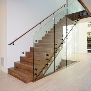 wood staircase with glass railing