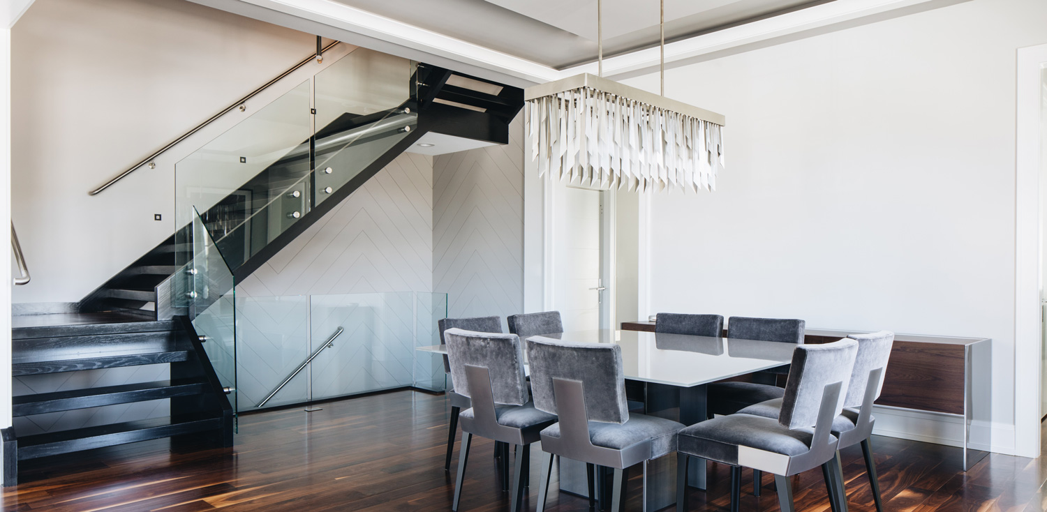 dark staircase with glass sides