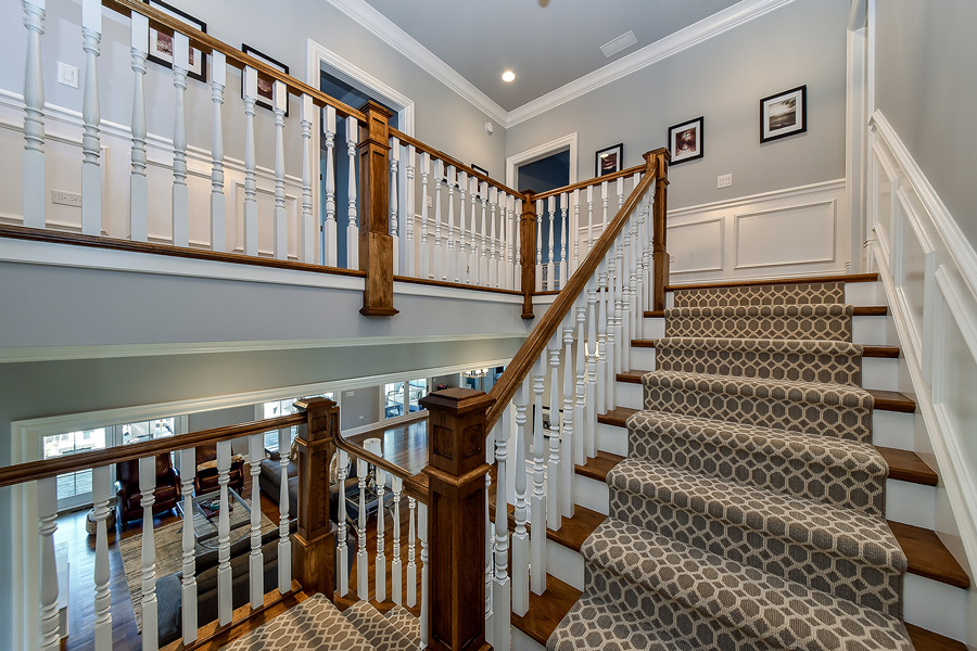 wood staircase with patterned rug